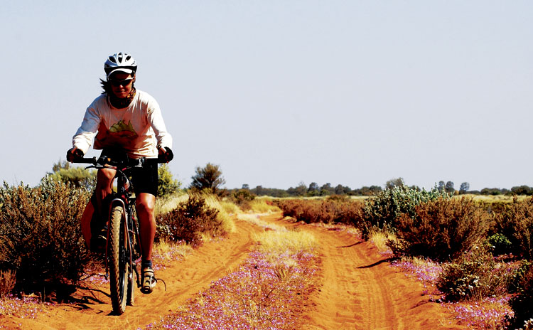 Kate Leeming pushes hard through WA's 2000km Canning Stock Route.