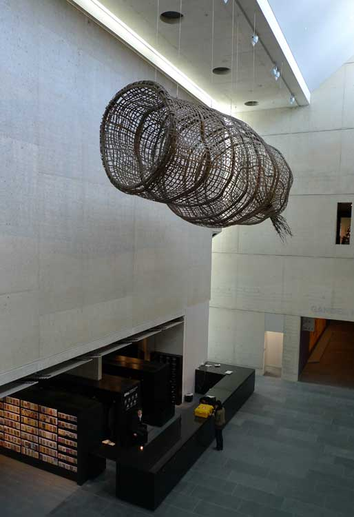 A fish trap hangs over the new wing of the NGA's atrium