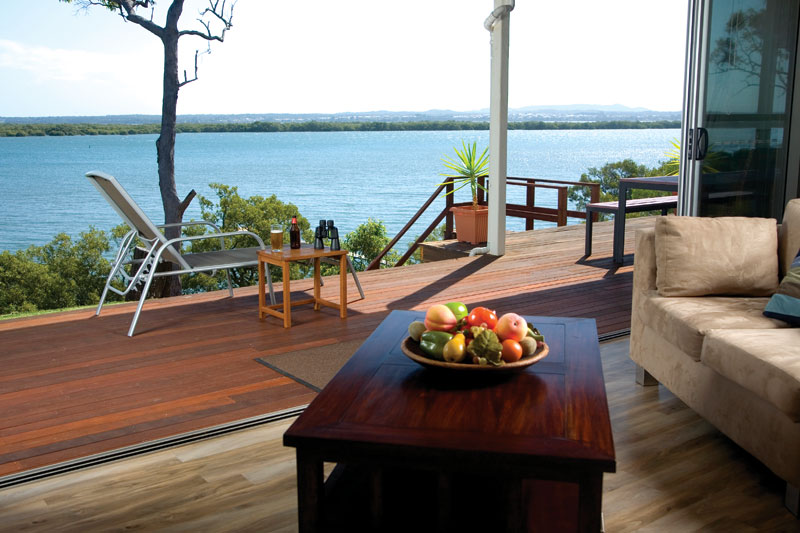 Slide back the glass doors and bring the expansive vista of Moreton Bay inside