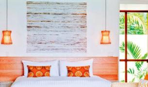 A chic, beachy-feel bedroom at Lizard Island.