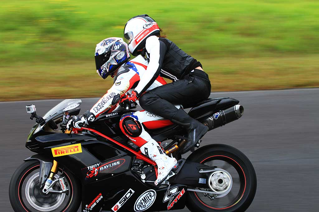 Troy Bayliss and Zoe Naylor going round the track