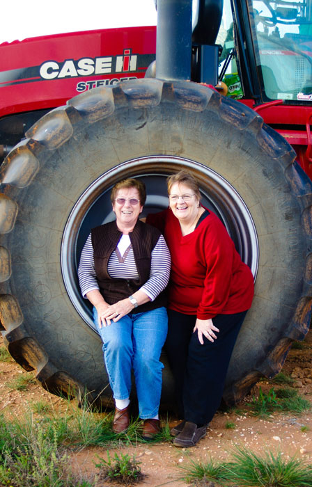 Visitors in a tractor wheel at Turlee Station