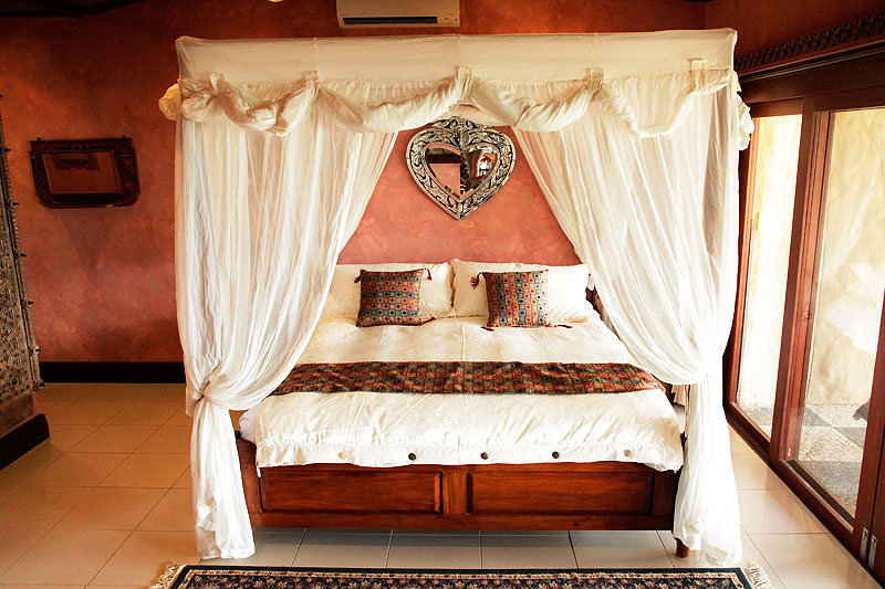 A romantic canopied four-poster bed is a perfect wedding-night inclusion.