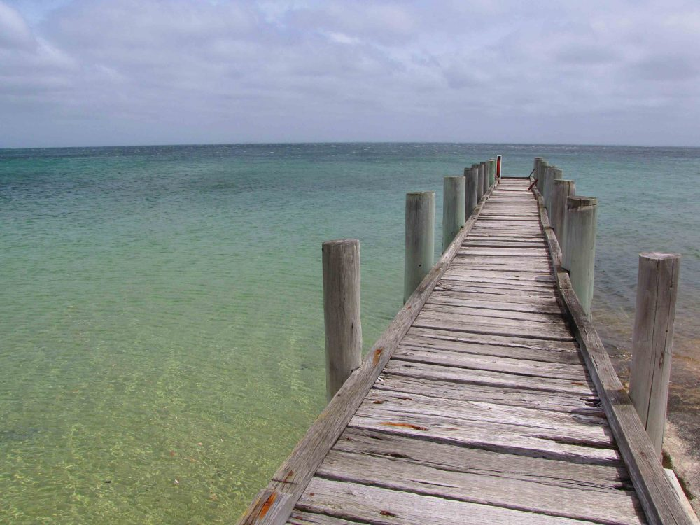 Wooden jetty on the 6km-long Whitemark Beach