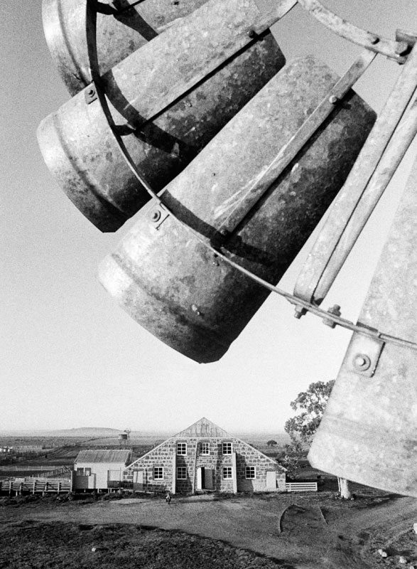Mount Hesse windmill & Shearing Shed, 1982: This was shot early in the morning in Winchelsea in Victoria. The shed is double-storey bluestone with beautiful nine-pane windows and a peaked roof of corrugated iron.