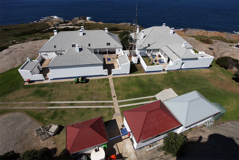 View of the cottages and shadow of the Montague Island lighthouse from above. Image by Solveig Walkling