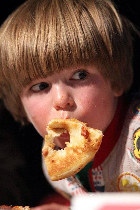A young boy in the pie-eating competition at Armageddon.