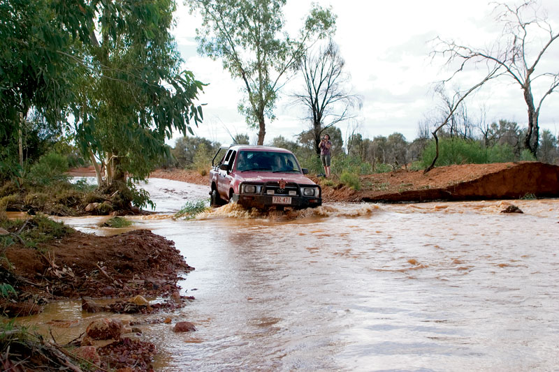 The trusty red truck takes a river crossing with ease. Image by Robyn Rosenfeldt