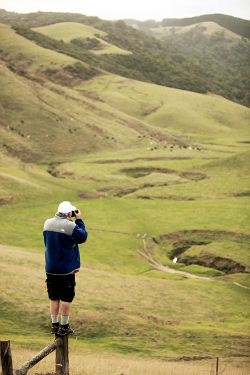 View of hills and mountains from the walk to Johanna Beach camp site. Ken Duncan taking photo from fence post.