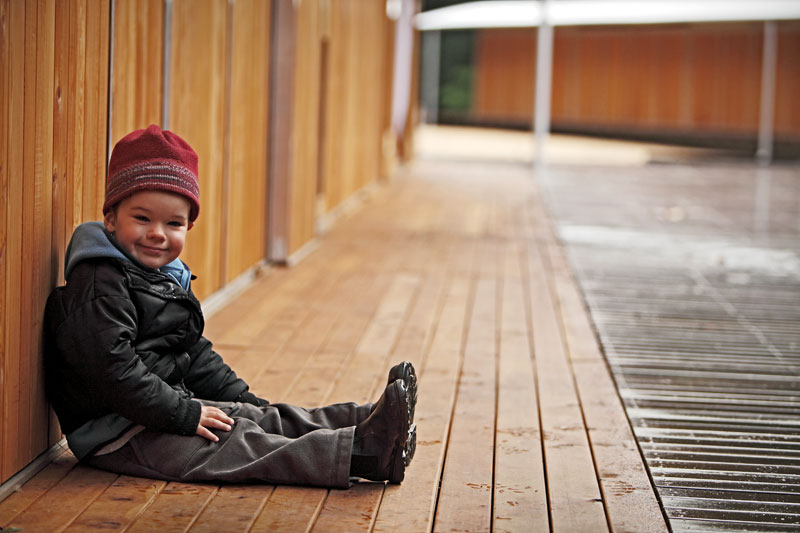 View of young boy (Samuel Ronan – son of owners) at the Bothfeet Walking Lodge, Victoria.