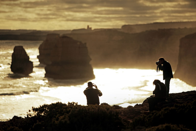 Ken Duncan and co captured snapping away with the 12 Apostles as a stunning backdrop
