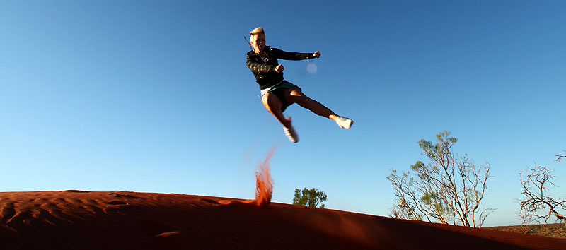 AT Art Director Jane Abma trying out her ninja moves on a dune a few kilometres outside of Yulara.