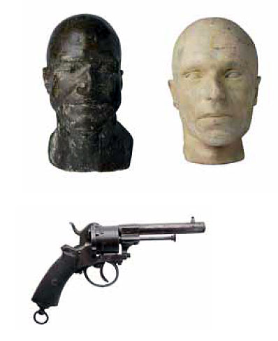 Deathmasks of Captain Moonlite and gang member Thomas Rogan, plus a 19th century revolver,