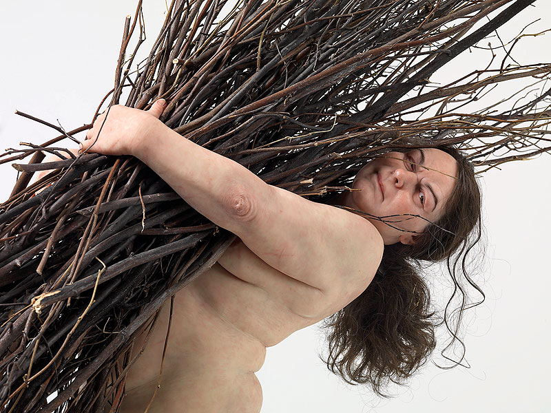 Woman with sticks 2008, Silicone, polyurethane, steel, wood, synthetic hair, Private collection, Ron Mueck courtesy Anthony d'Offay, London, Photo by Mike Bruce