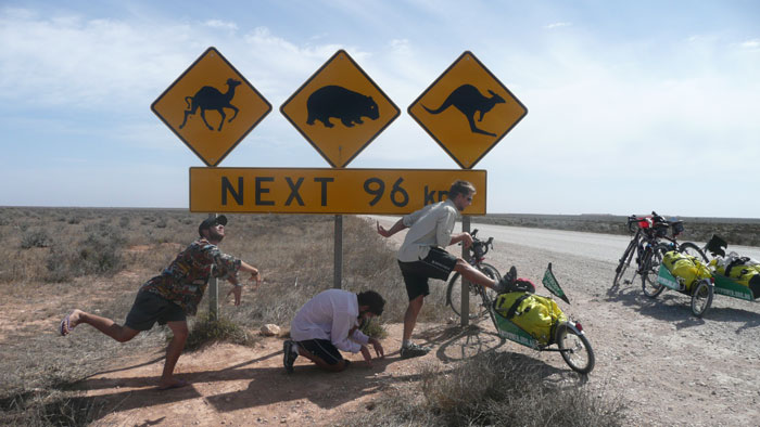 Warming up against the Nullarbor Plain's most famous Australian Road sign