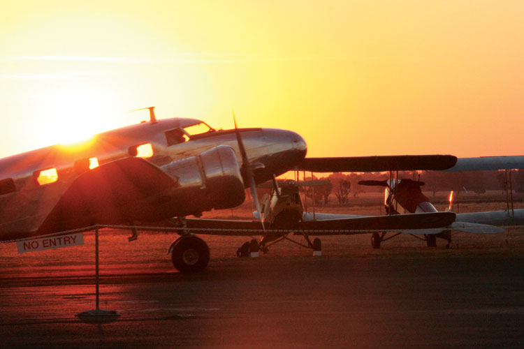 The sun rises over a parked Lockheed 12. Images by Craig Hall