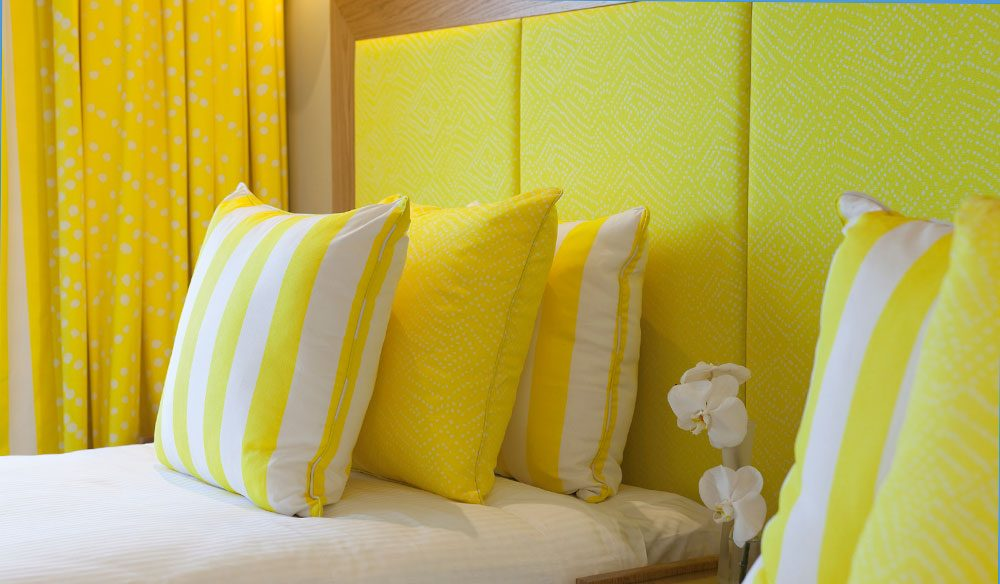 Citrus-inspired twin room in Hayman Island's new penthouse, designed by Diane Von Furstenberg