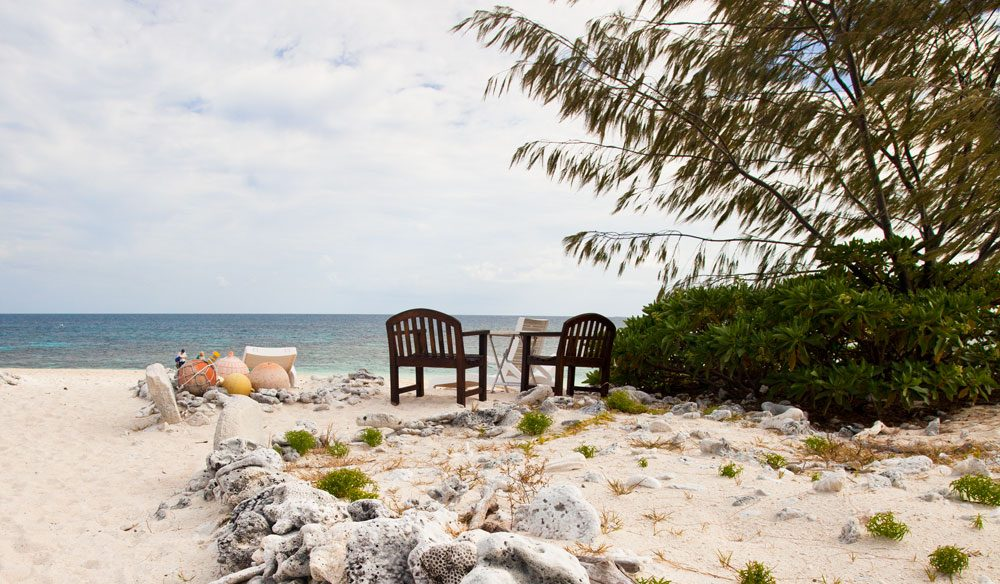 Guests on Wilson Island congregate at the beachfront for sunset daily