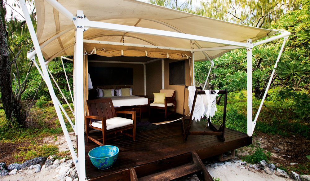 Wilson Island's private guest tents - set on a private beach, with a private hammock and deck chairs.