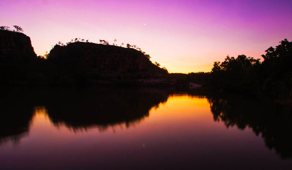 A stunning Northern Territory sunset mirrored in the Katherine River below.