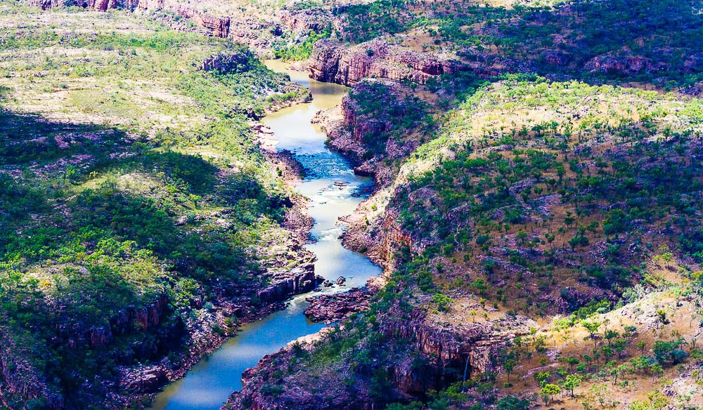 The Katherine River flows through 13 separate gorges that weave their way through the Arnhem Land Plateau.