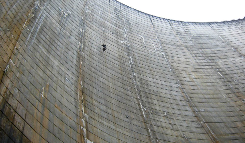 Half-way down the face of the Gordon Dam abseil