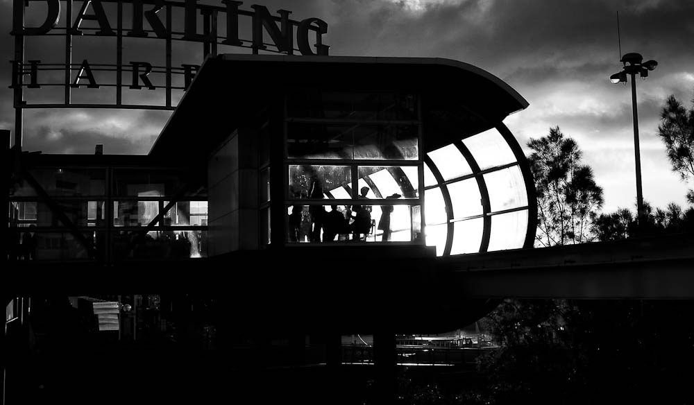 The sun sets on the Darling Harbour monorail station.