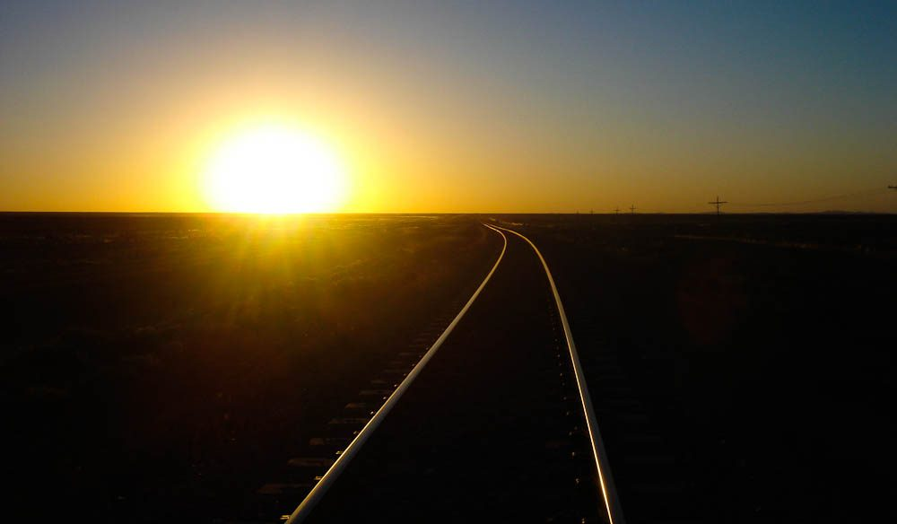 The Indian Pacific rolls into nothingness (Rodney Avery).