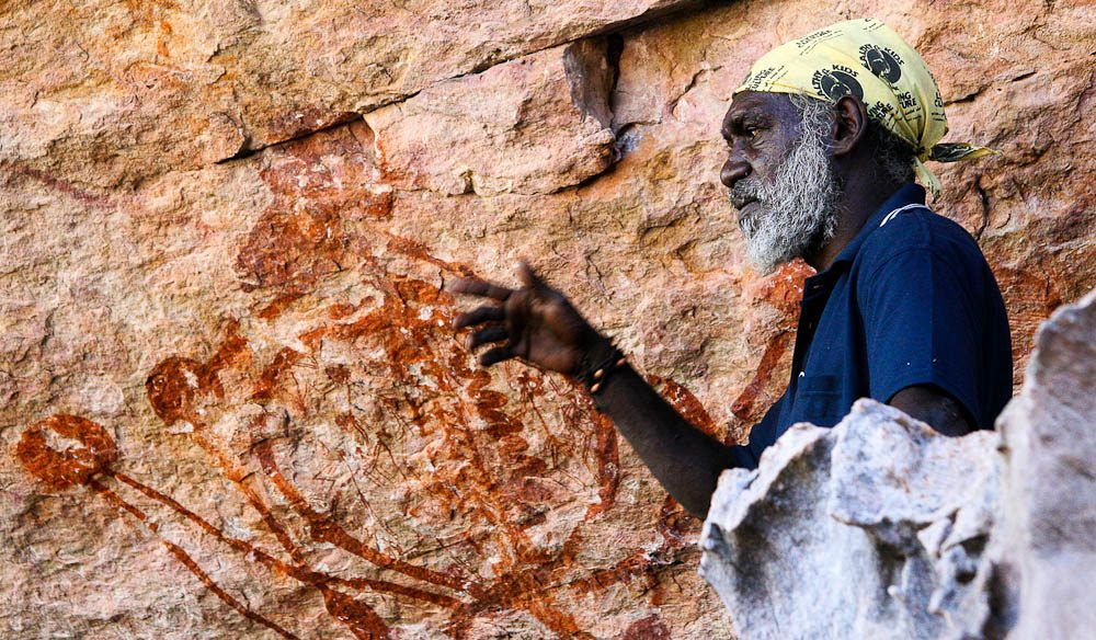 An Indigenous guide at Injalak Hill explaining the rock art.