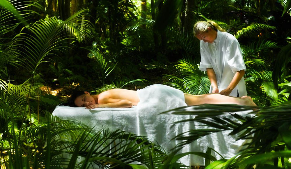 There are massages and yoga among Hayman's palm trees.