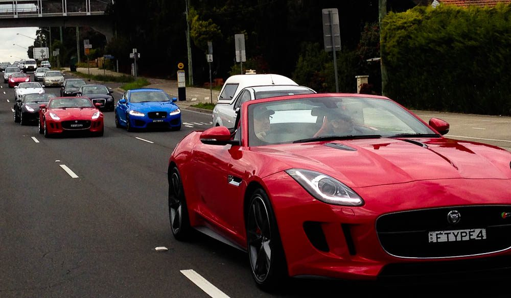 A Jaguar F Type convertible convoy.