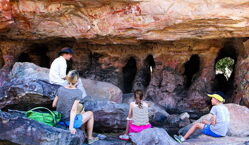 Discovering rock art at Mt Borradaile's catacombs.