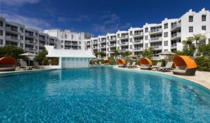 The white colour scheme and the pool furniture at the refurbished Sheraton Noosa Resort & Spa.