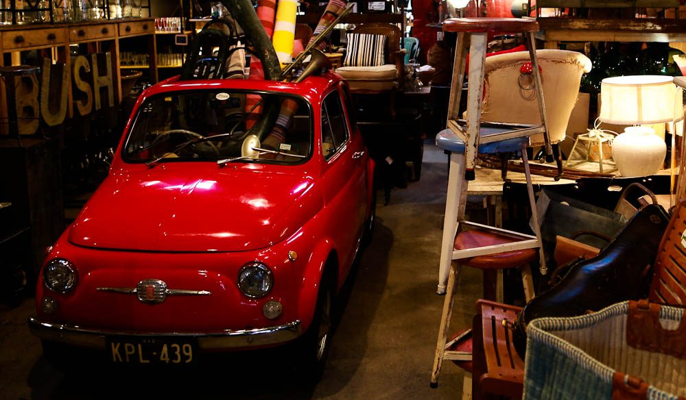 Ici et la is a real life treasure chest, complete with stools, rugs, and a little red engine.