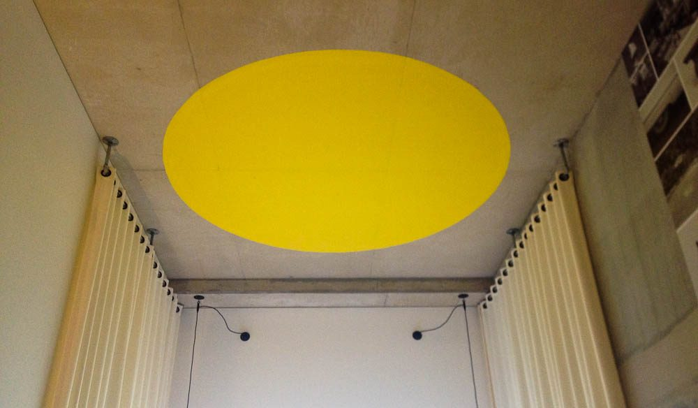 Atura's signature giant yellow ceiling spot.