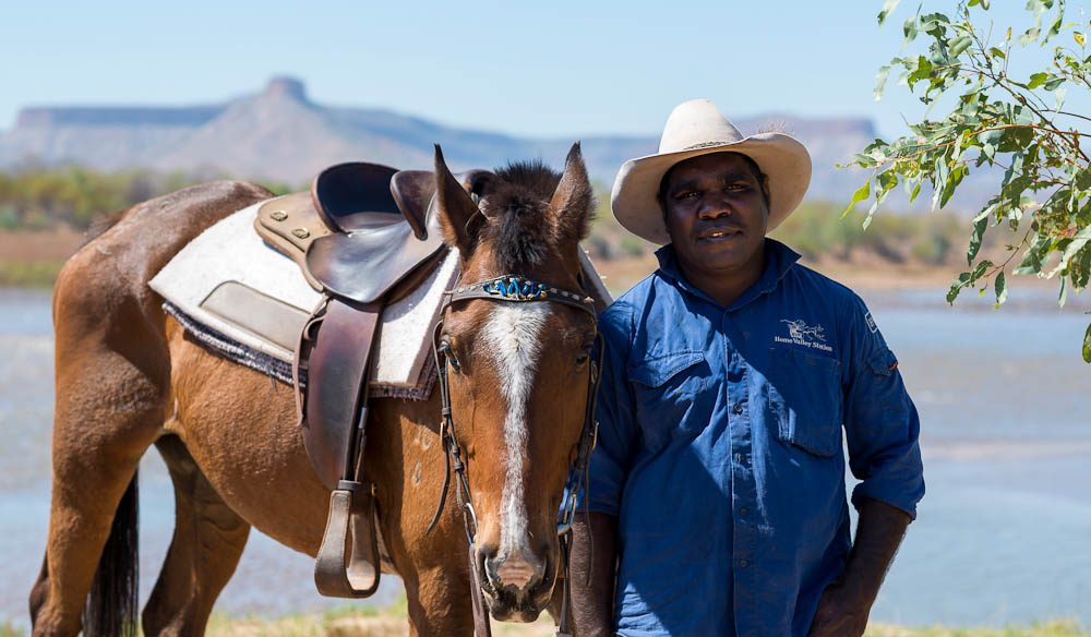 Head stockman Cyril Yeeda, who was trained here, and his horse Bundy