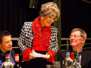 Sybil (Karen Hamilton) takes cares of (and embarrasses) guests at Faulty Towers The Dining Experience (Photo: Ron Rutten).