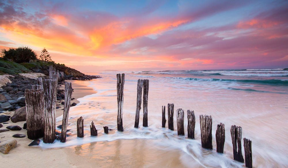 Sunset through diminishing barriers at Lennox Head (by Larissa Dening).