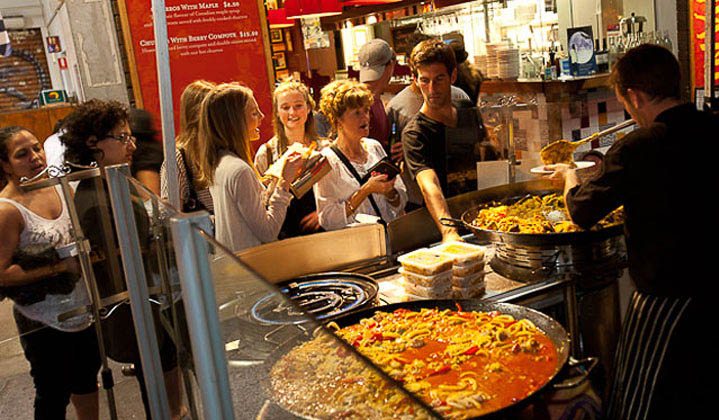 Hungry customers salivate over Melbourne Night Market's creative culinary delights.