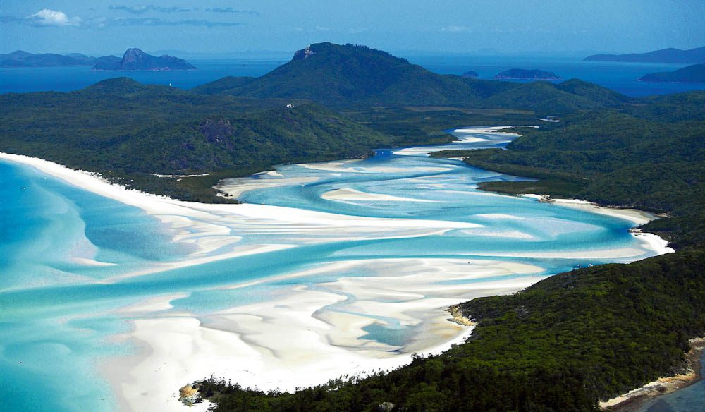 A scenic flight will help you drink in all the colours of Whitehaven Beach, Whitsunday Island.