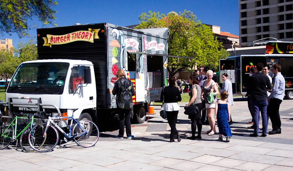 Adelaide locals swarm around the impromptu fleet of food trucks now cruising the city.