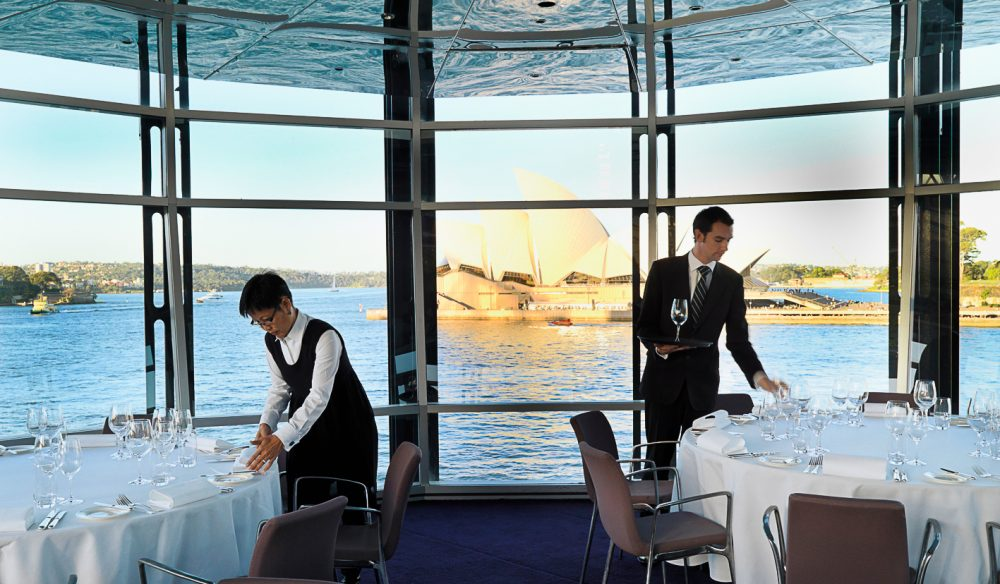 A view like no other - waiters preparing the Quay for dinner service