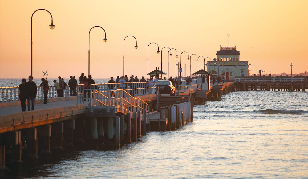 The sun sets but the action doesn't at St Kilda Pier and Pavilion.