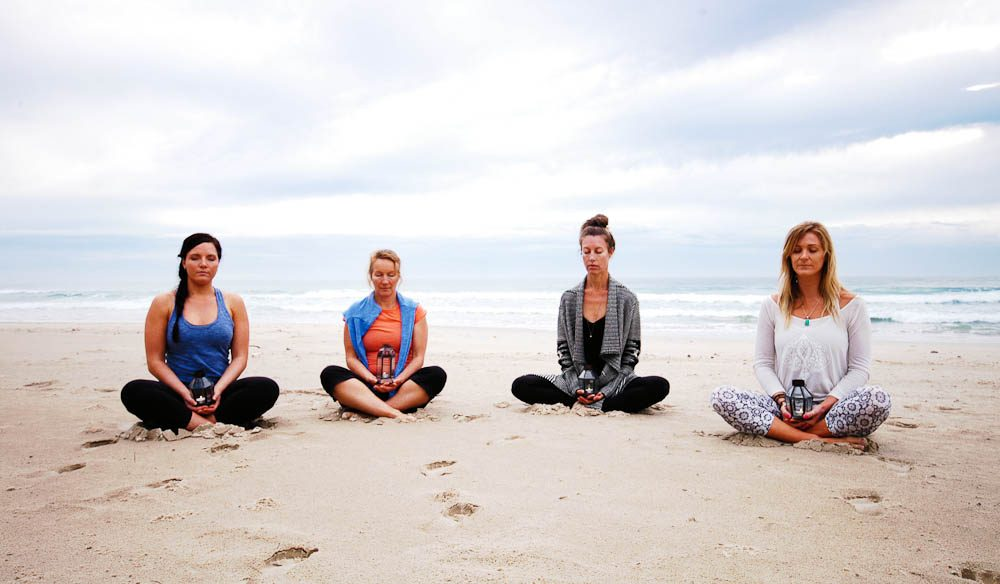Meditation sessions on the white sand beach (Alisa Katan Photography).