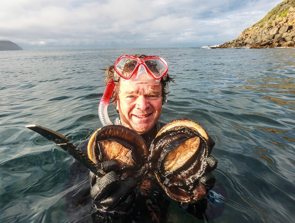 Rob Pennicott picks an abalone 'off the shelf' in Tassie (photo: Peter Aitchison).