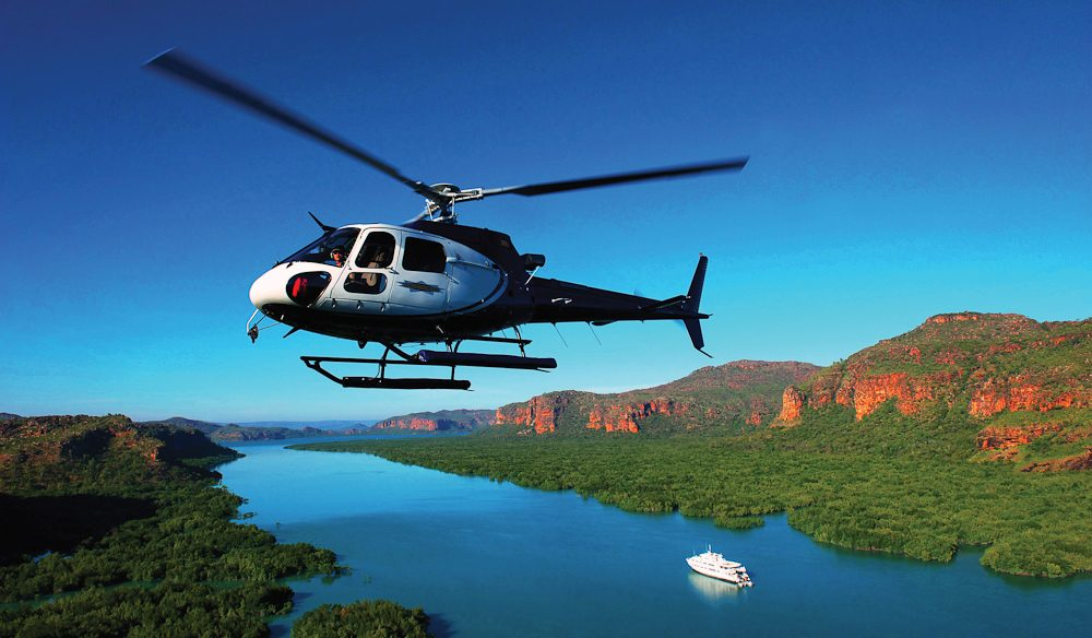 Cruising the Kimberley Coast on the luxury ship True North - then hop on the ship's onboard helicopter for a scenic flight.