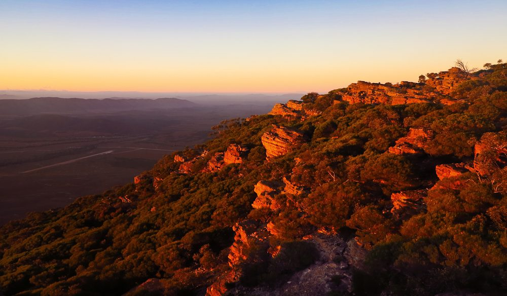 The magnificent sunrise from Rawnsley Bluff, looking over Rawnsley Park Station, Flinders Ranges, South Australia.
