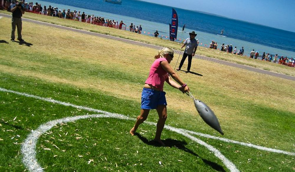 Jacqui Hockaday tosses the tuna at Port Lincoln's Tunarama (photo: Port Lincoln Tunarama).
