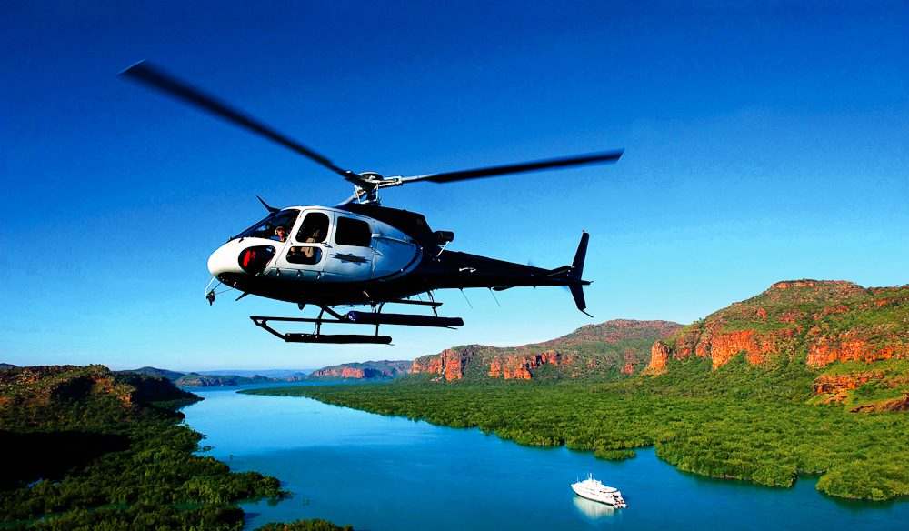 Luxury cruise ship True North's helicopter can chopper you off to a private Kimberley waterfall picnic.