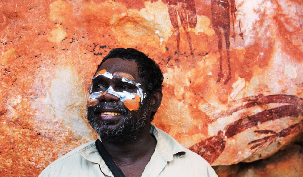 Senior Traditional Owner, Albert Peurmora, with Gwion Gwion rock art Kimberley Coastal Camp